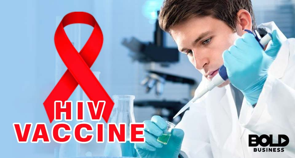 Researcher in lab, HIV logo on top.