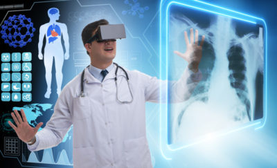 researcher wearing VR glasses
