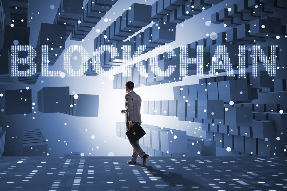 guy in futuristic hallway with blockchain above him