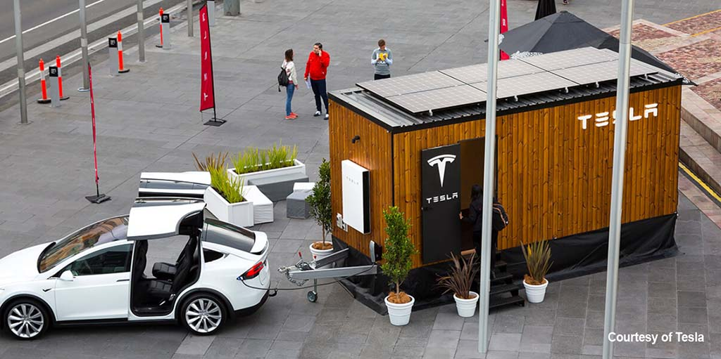 a photo showing an aerial view of the Tesla Powerwall Tiny House and the solar panels on its roof