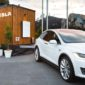 a photo of a white Tesla X that is powered by the Tesla Powerwall Tiny House it hauls