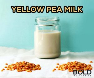 Glass of milk and yellow peas.