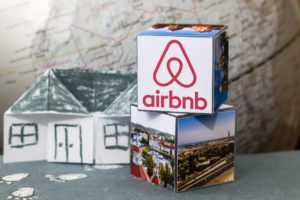 Airbnb logo on origami blocks.