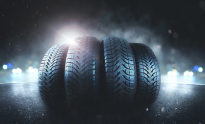 self healing rubber Tires backlit by car headlights