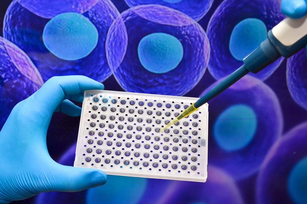 lab testing equipment on a background image of cells