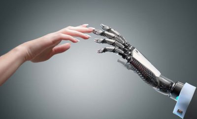 Human hand and robot hand - Illustration of Most Workers Don't Fear Robots