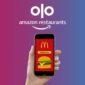 A phone with a McD app and Olo and Amazon logos