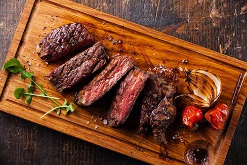 Steak on a wooden platter.