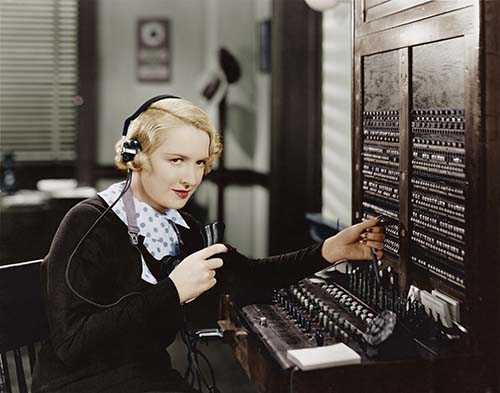 An operator on an old-time switchboard.