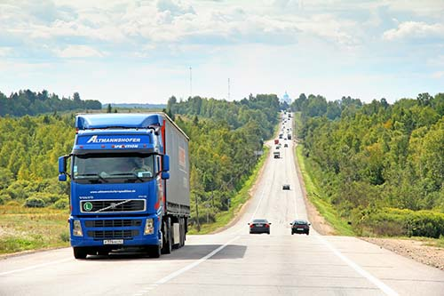 Blue Volvo Truck on Highway