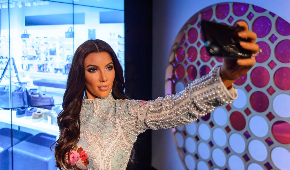 Kim Kardashian photographing herself, what her shazam for fashion app can do?