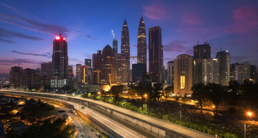Skyline of Kuala Lumpur at dusk - New Home for Oracle Digital Hub