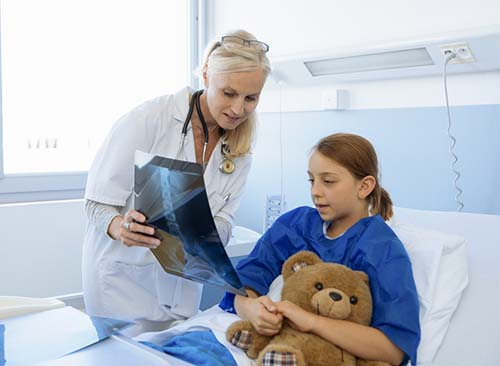 a doctor presenting test result to a child patient