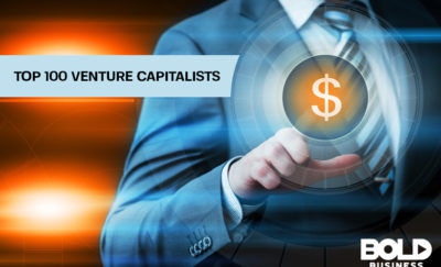 a photo of a faceless man in a business suit pointing to a dollar sign beside the written words