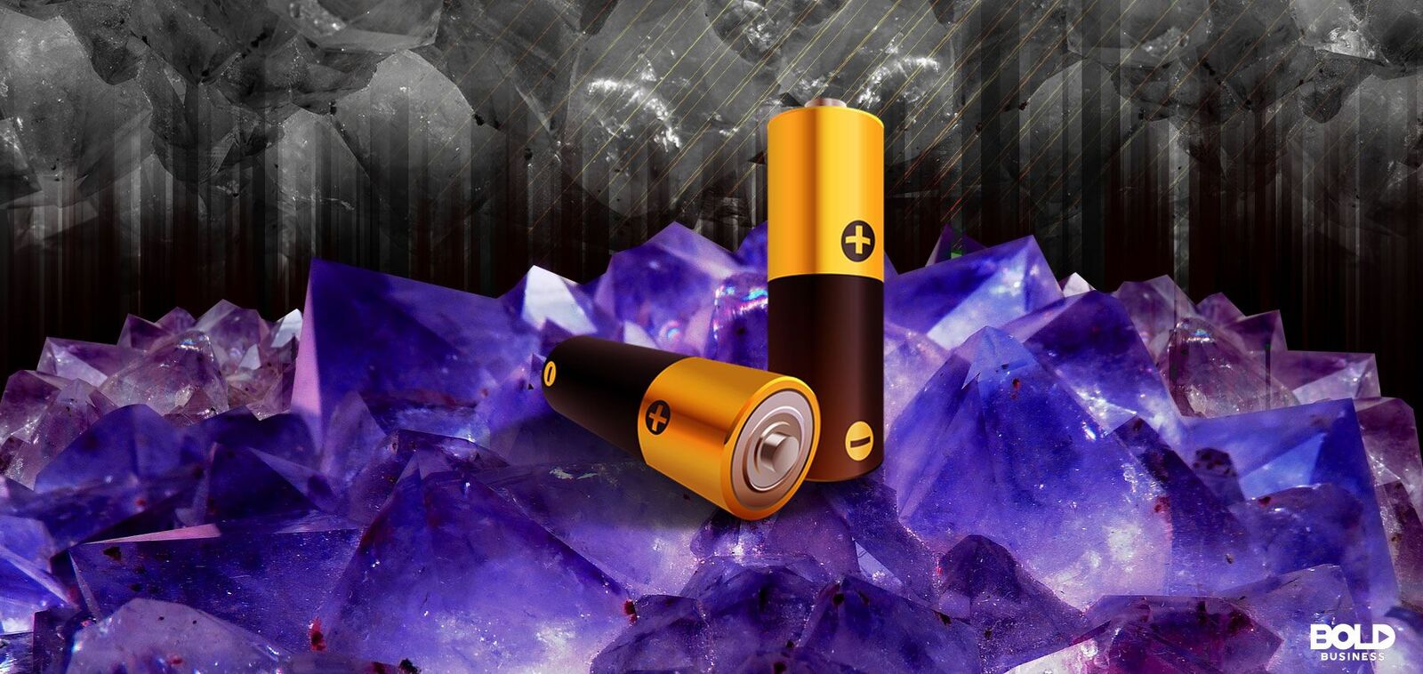 two batteries sit on cobalt ore