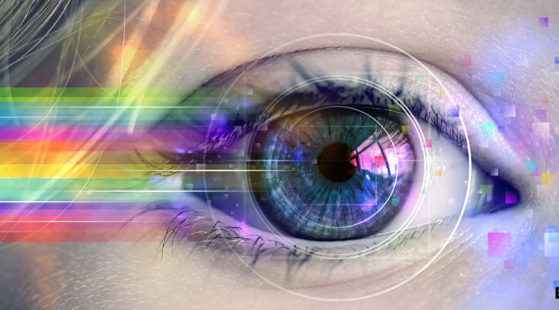 a close up photo of a woman's eye with a rainbow of colors streaming from it amid developments in technology related to anesthesia for eye surgery