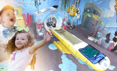a photo of two smiling children beside an image of an MRI machine like one from the GE MRI Adventure Series