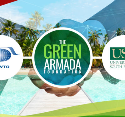 a photo of a global partnership for sustainable tourism shown by the company logos of Green Armada Foundation, UNWTO, and USF