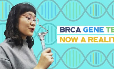 Woman holding a BRCA Gene Breast Cancer Home Test