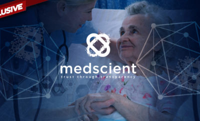 nurse leaning over a female patient with the mediscient logo superimposed