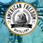 American Freedom logo overlay photo of American Freedom distillery barrels