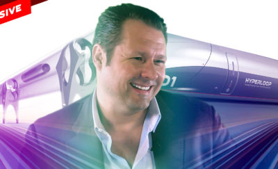 CEO Dirk Ahlborn with image of Hyperloop Tube