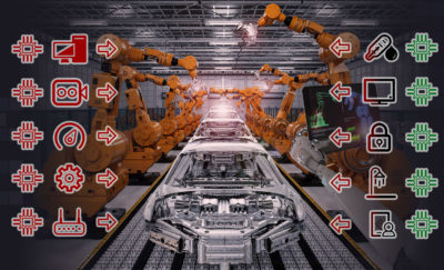 image of robotic arms assembling a machine