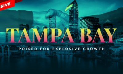 Image of Tampa skyline with hands shaking and text that reads