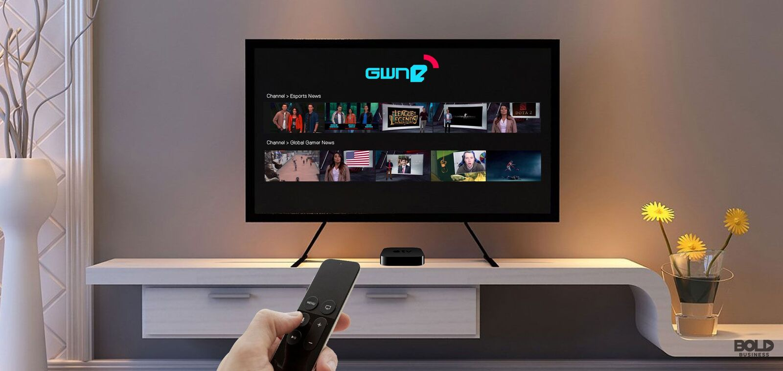 Image of apple remote pointed at tv featuring GWNe home screen
