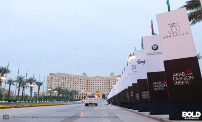 Photo of hotel in saudi arabia and arab fashion week banners lining sidewalk