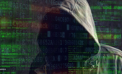 image featuring computer coding and a hooded figure of a person