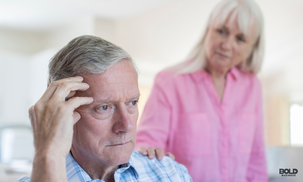 Alternative treatments for alzheimer's: elderly couple with the woman comforting the man