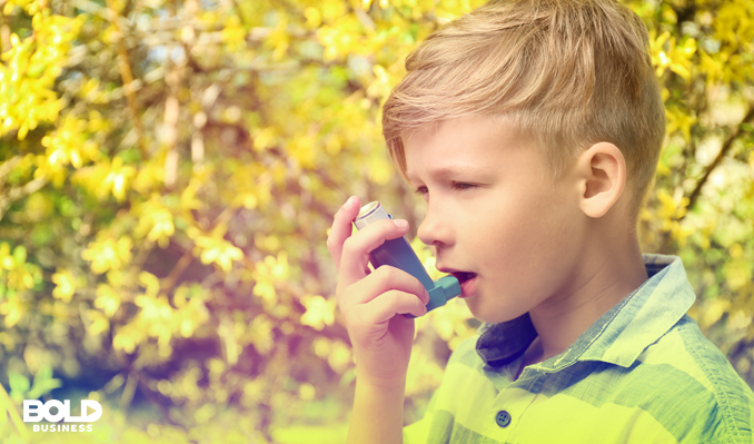 Young kid with an inhaler