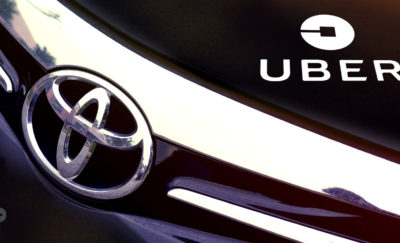 self-driving uber and toyota logo