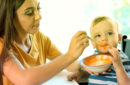 Mom Feeding Baby Meat