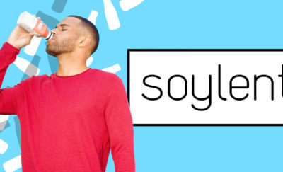 red man in shirt drinking soylent