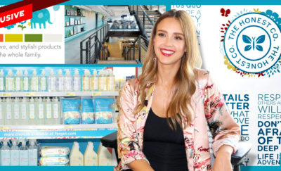 a photo of Jessica Alba sitting in front of a photo of the products of The Honest Company