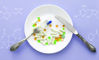 diet based on genetics with different kinds of pills on a plate