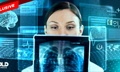 a photo of a woman looking at an x-ray from an electronic health record system solution given by Wave Health Technologies