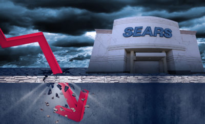 sears building in a dark scenario with a red arrow pointing down