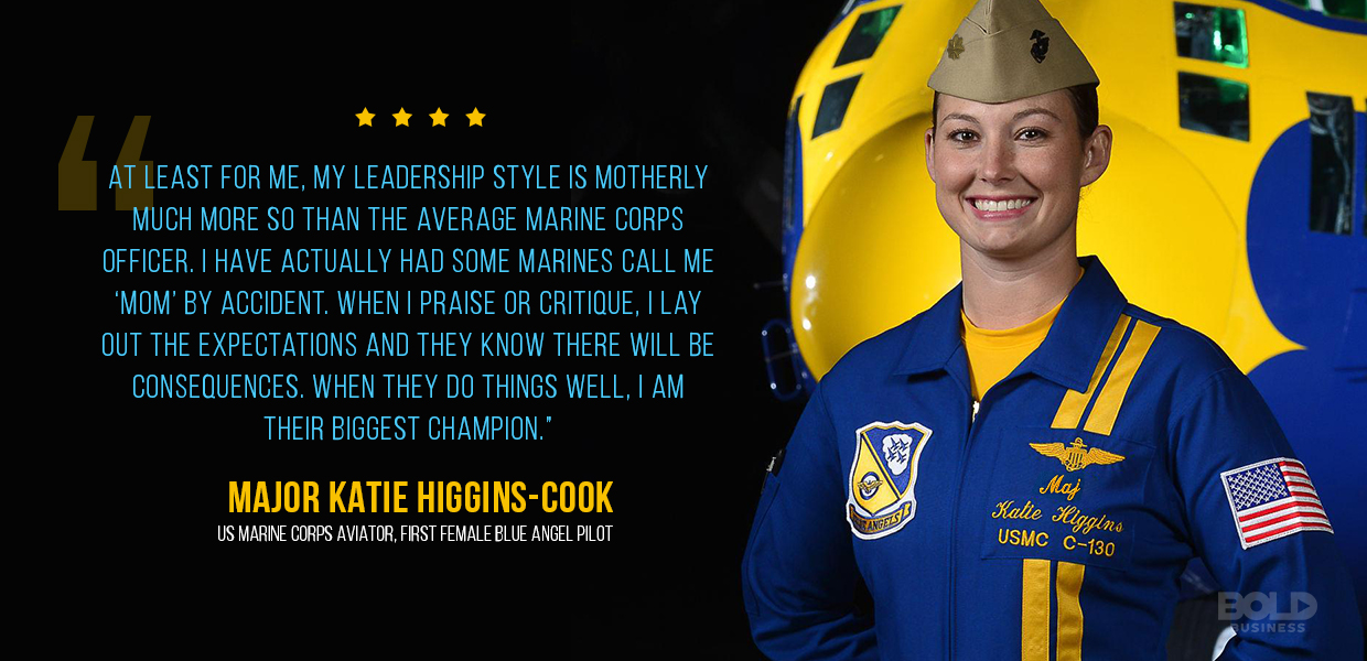 Blue Angels Team Katie Higgins Cook smiling in a blue suit