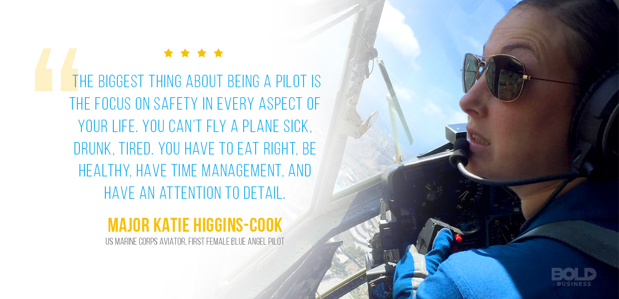 Katie Higgins Cook side view flying an aircraft