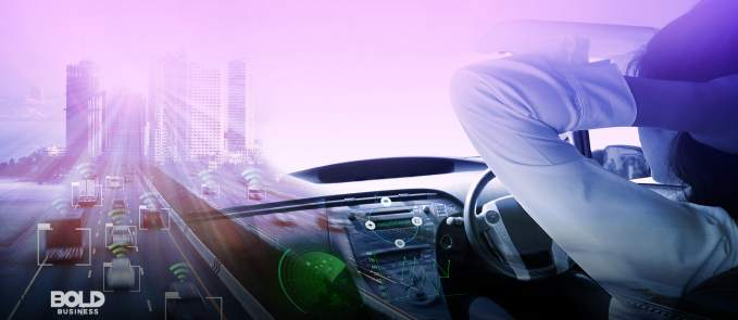 a photo of a relaxed driver with hands behind his head as his vehicle equipped with self-driving technology cruises down the highway with other cars