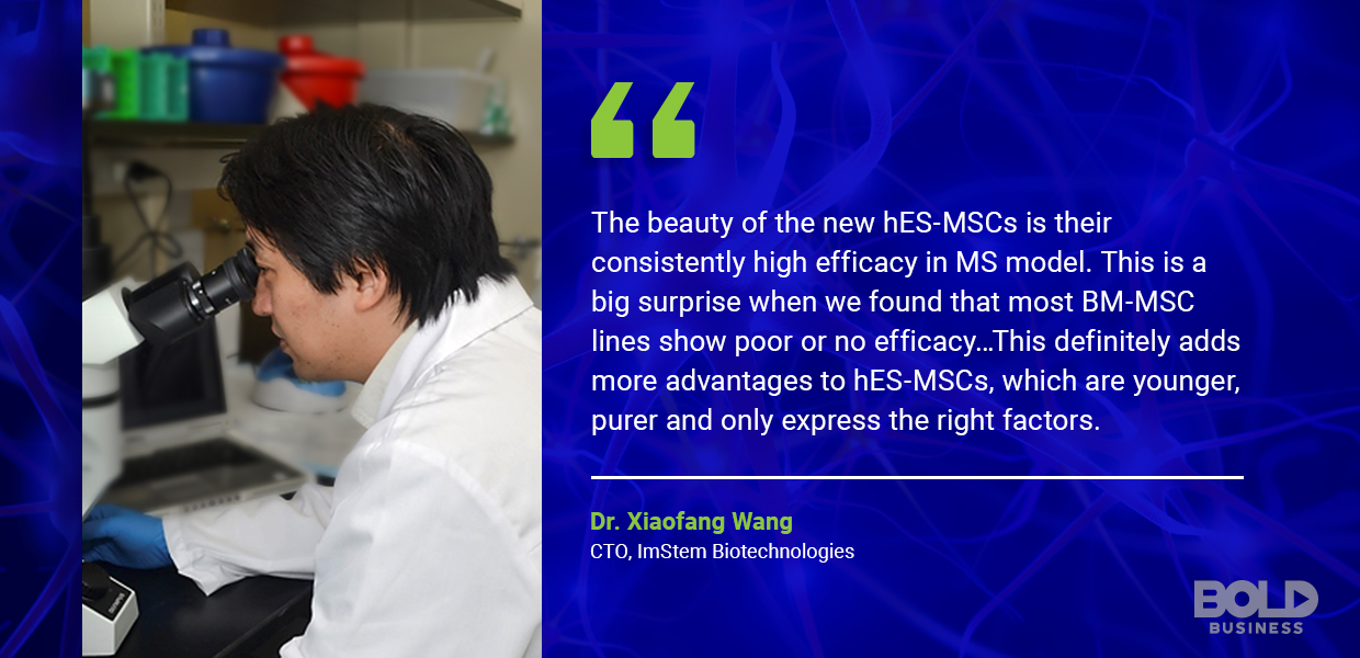 cure for ms, dr xiaofang wang in a lab gown looking into a microscope