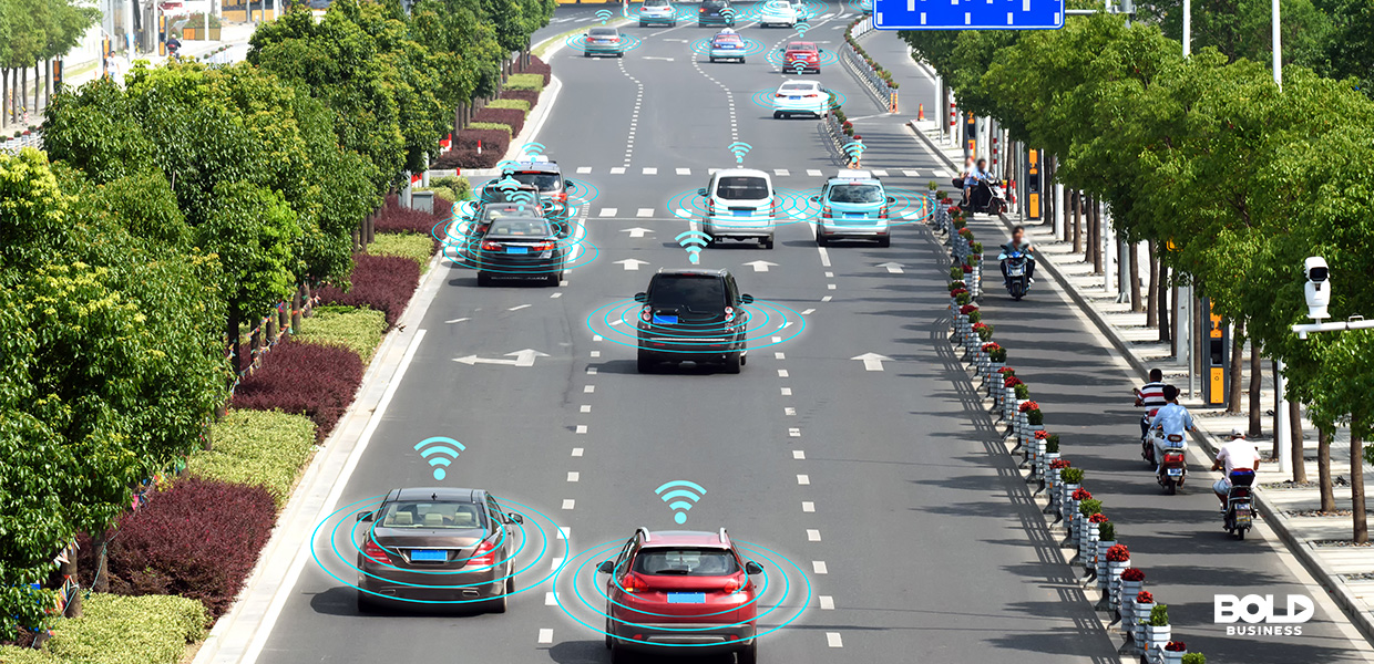a photo of vehicles equipped with self-driving car technology in a four-lane highway