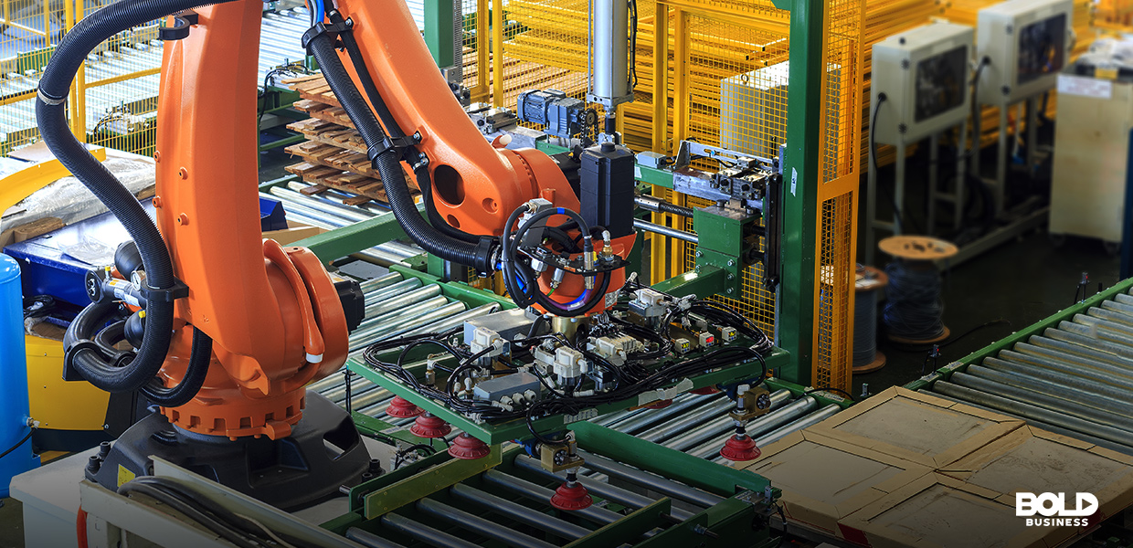 a photo of a robot sorting out boxes inside a warehouse amidst the progress in supply chain automation and several companies' recognition of the advantages of robots today