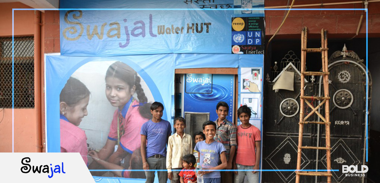 top innovative companies, young indian people standing in front of a swajal water hut