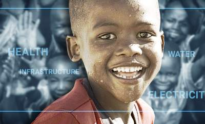 underserved niche market, a black male child smiling at the camera with a gray scale background of smiling children