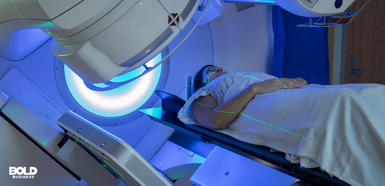 a photo of a patient lying down on a bed beside a machine while waiting to undergo radio frequency therapy