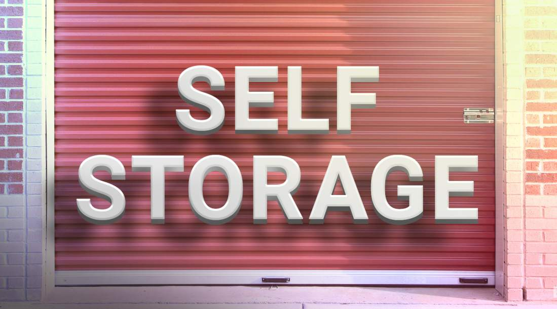 """a photo of the word """"self-storage"""" in front of a closed commercial storage facility amid the growing and resilient self-storage industry"""